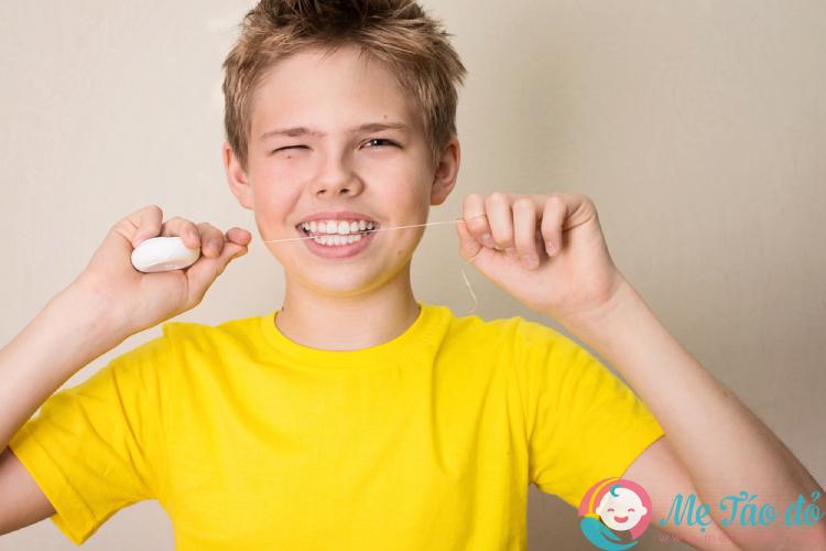dùng chỉ nha khoa để ngừa sâu răng